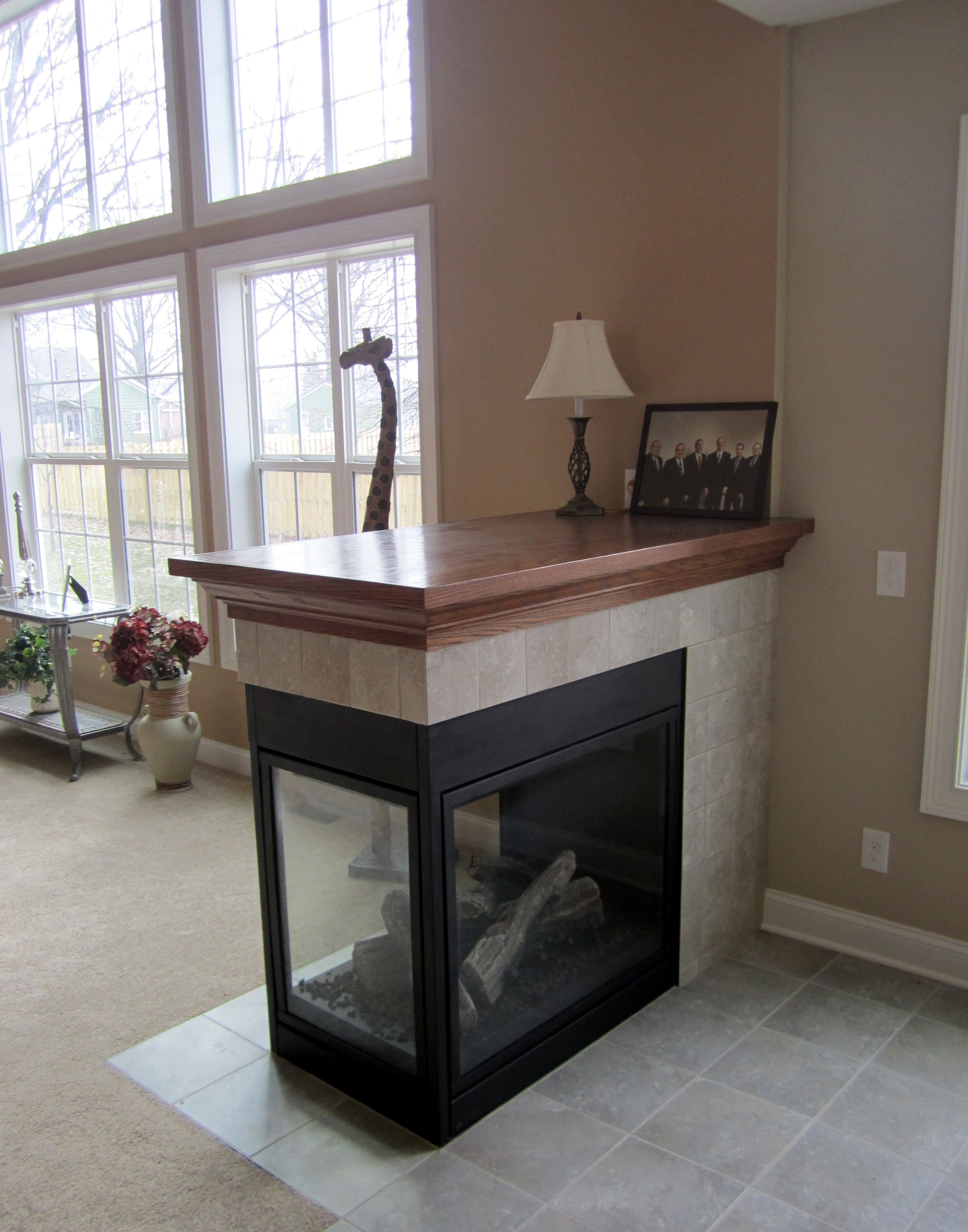 Three Sided Fireplace With Tile Surround And Oak Mantle