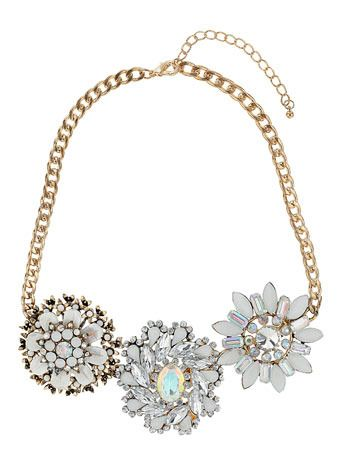 MISS SELFRIDGE Flower Collar £30.00 - Make like a magpie and add a scattering of jewels to complete summer's simplest look