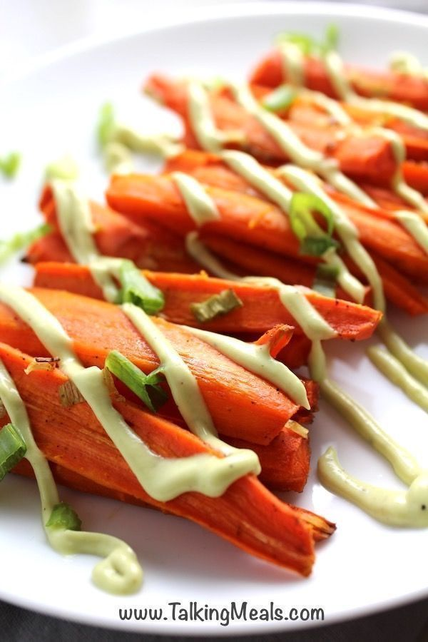 Roasted Carrots with Cumin and Avocado Crema ~ Talking Meals Carrots and Avocado are perhaps an unexpected, but DELICIOUS combo!  This is a simple and delicious side dish that you will absolutely love.  Simply roasted with olive oil, Cumin, Salt, and Pepper, these carrots get sweet and savory delicious.  Paired with Avocado Crema, this is a perfect easy recipe.