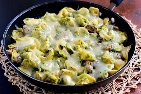 This Pesto Tortellini Bake is filled with fresh pasta, tangy pesto sauce, juicy mushrooms, and mozzarella cheese!