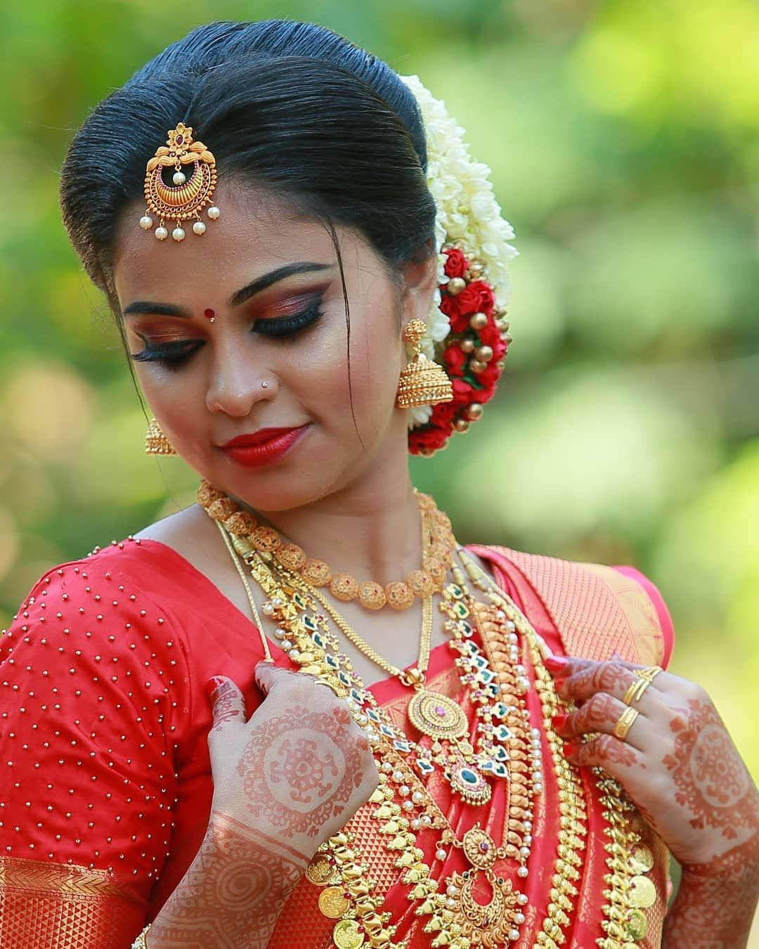 Image may contain 1 person, closeup Kerala bride, Bride