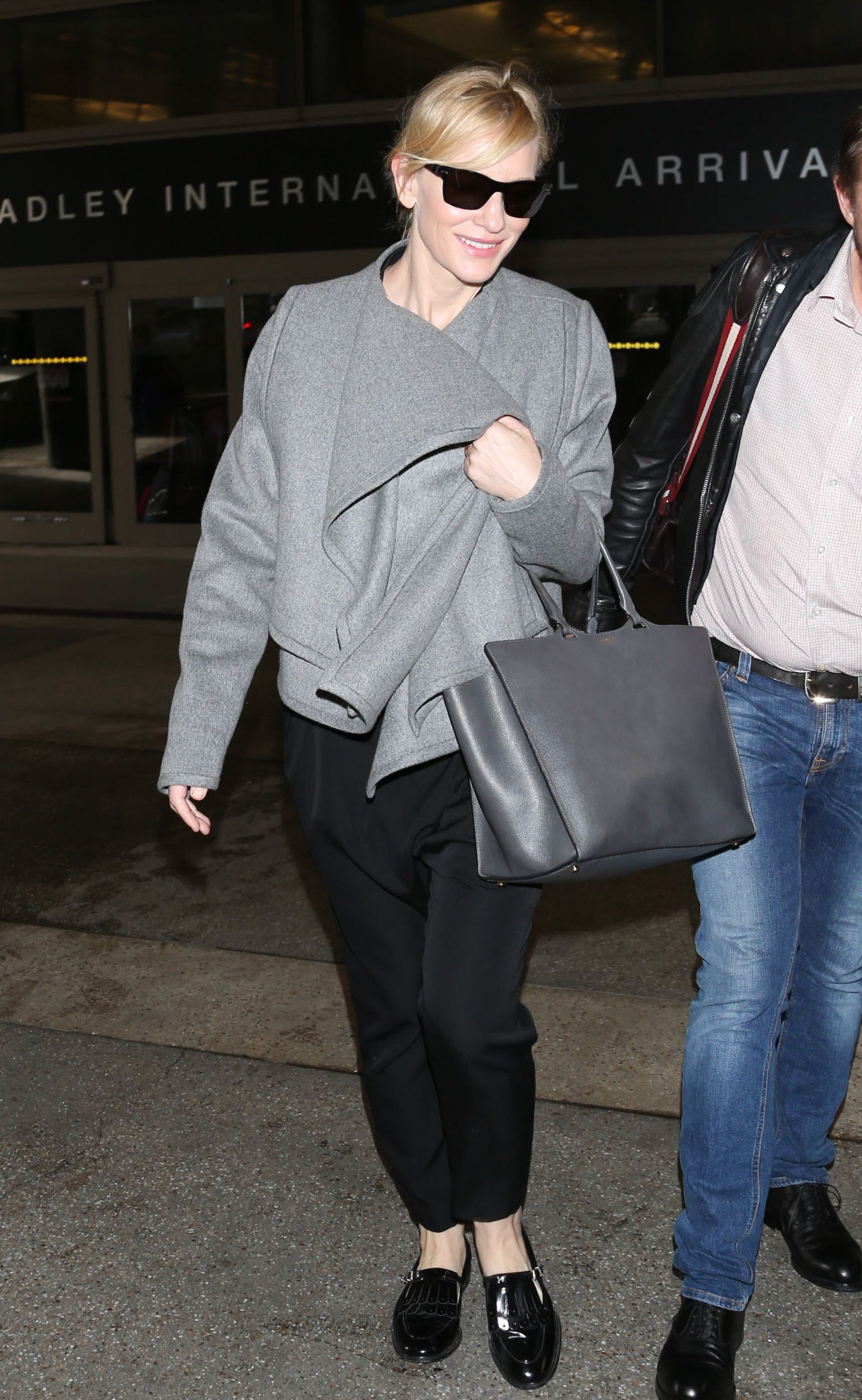 Effortlessly chic: Cate Blanchett completed her travel look with a matching grey oversized Giorgio #Armani handbag
