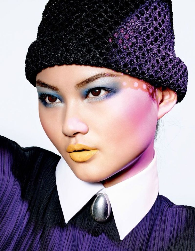 Makeup Creative and Image Director Peter Philips creates He Cong's vibrant blue eyeshadow and yellow lipstick look