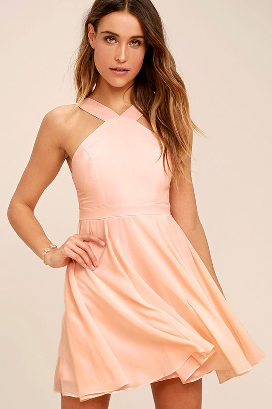 c58946e4d9 Our hearts will belong to the Forevermore Peach Skater Dress  til the end  of time! Semi-sheer shoulder straps form a modified halter neckline atop a  fitted ...