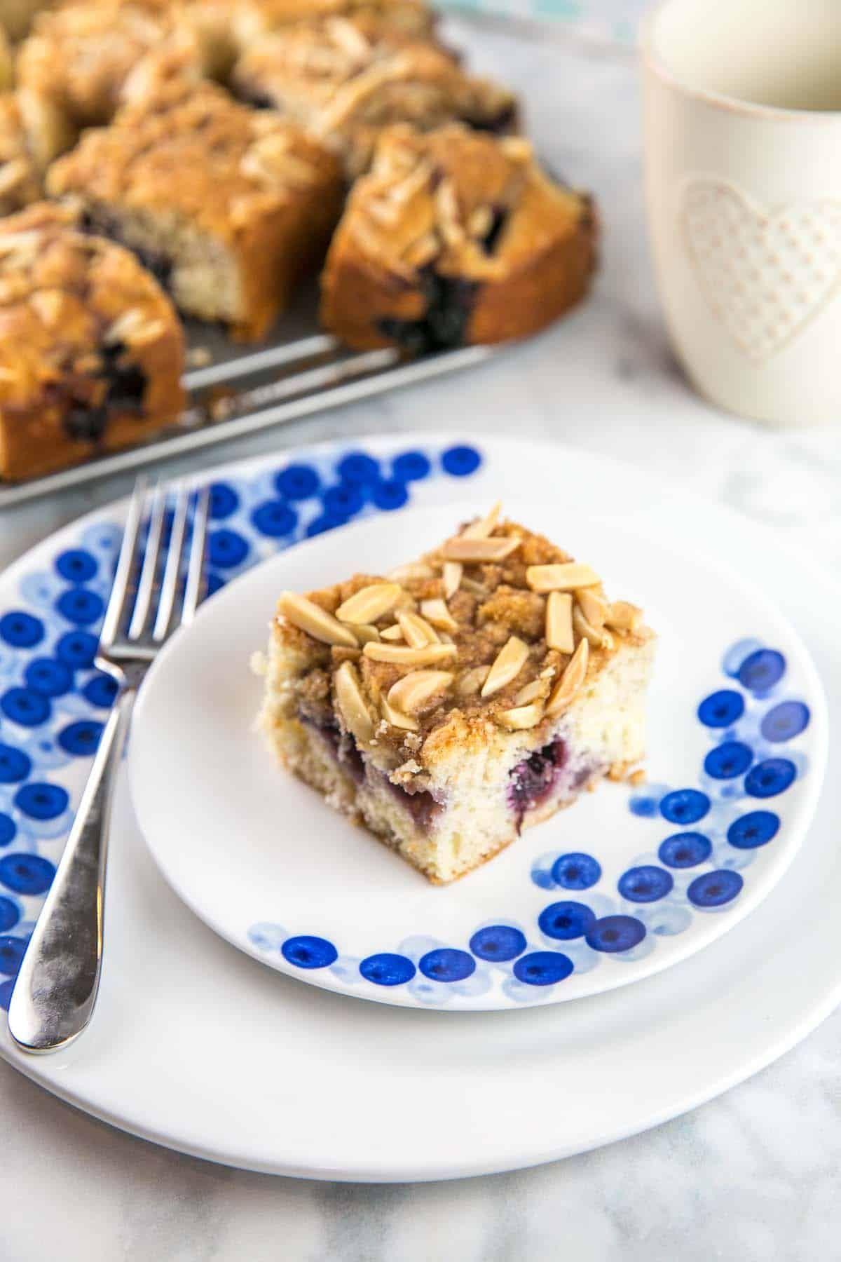 Almond Blueberry Breakfast Cake #buttermilkblueberrybreakfastcake Almond Blueberry Breakfast Cake: a light buttermilk blueberry cake with an almond streusel toping, perfect for breakfast or as as a not-so-sweet dessert. {Bunsen Burner Bakery} #breakfastcake #coffeecake #blueberrycake #buttermilkblueberrybreakfastcake