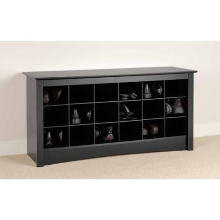 block black wooden shoe storage as bench with three lines and six rows  shelves placed on the cream floor,