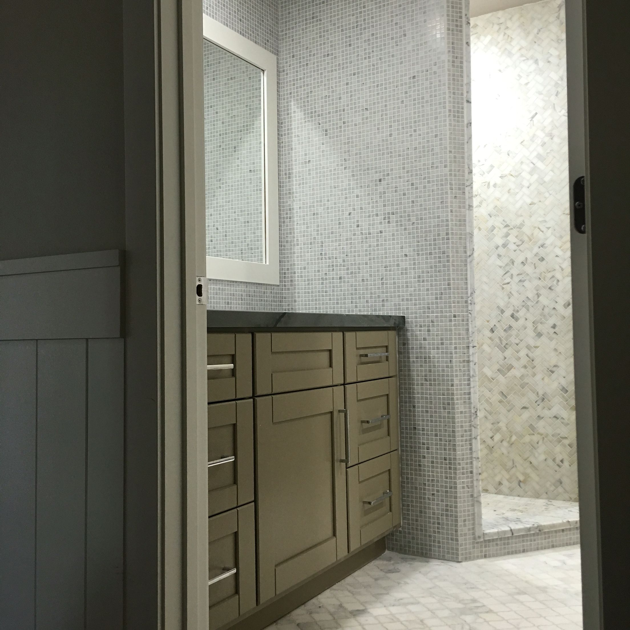 Carrara white marble arabesque mosaic floor tile heated by ditra 1x2 calacatta gold herringbone mosaic shower wall with the matching basketweave shower floor tile carrara carrera bianco 58 mosaic accent dailygadgetfo Gallery