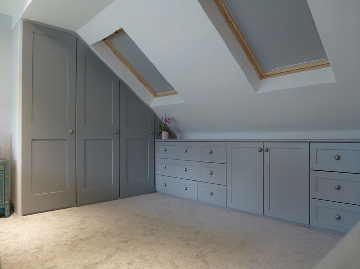 Photo of Fitted wardrobes built into the attic. Shaker style drawer cabinets …