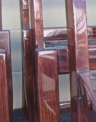 Detail Of High Gloss Finish On Oak Chairs