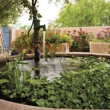 A 300 Gallon Raised Pond Is A Healthy Habitat For Goldfish To Help Maintain Its Ecosystem And Provide A Food Beautiful Backyards Small Water Gardens Diy Pond