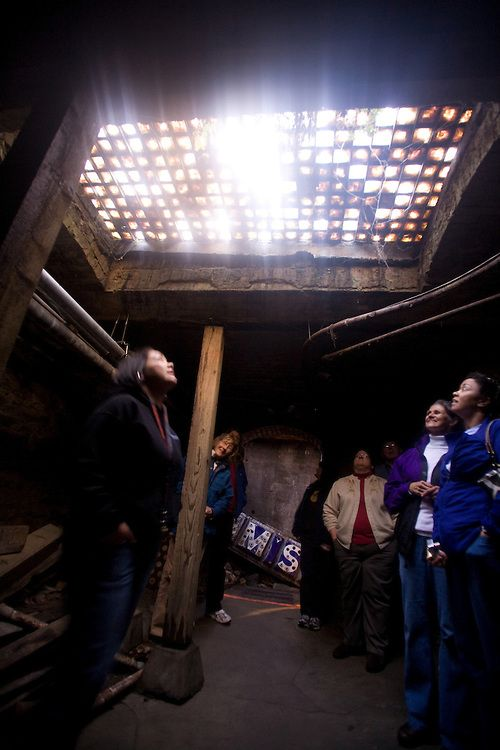 Underground Tour Of Seattle Tourists Gaze Up Through The Glass