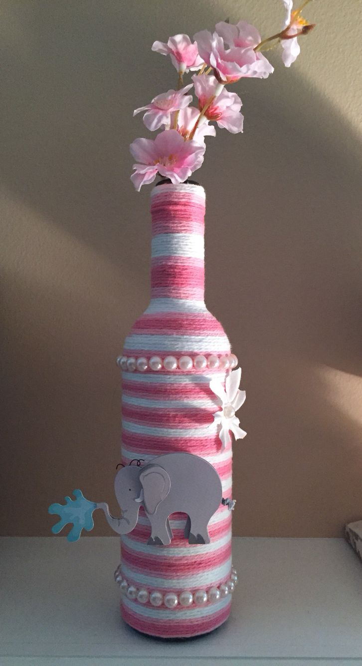 Yarn wrapped wine bottle made by me for a baby shower for Baby bottle decoration ideas