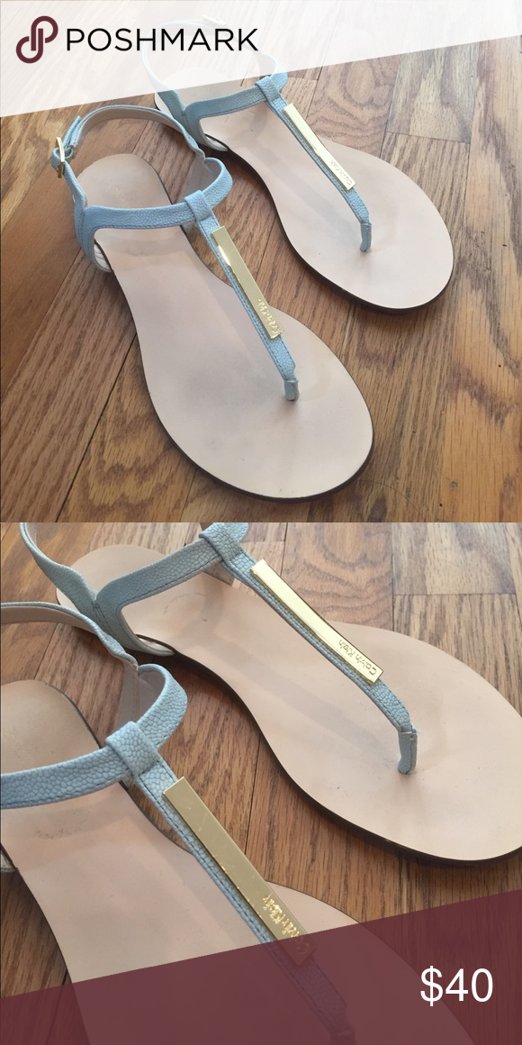 b26f2c01f70 Calvin Klein Size 8 Sandals Calvin Klein Samira Sandals. Flat T-strap  sandals with branded name logo on the front in metal. Gold hardware.