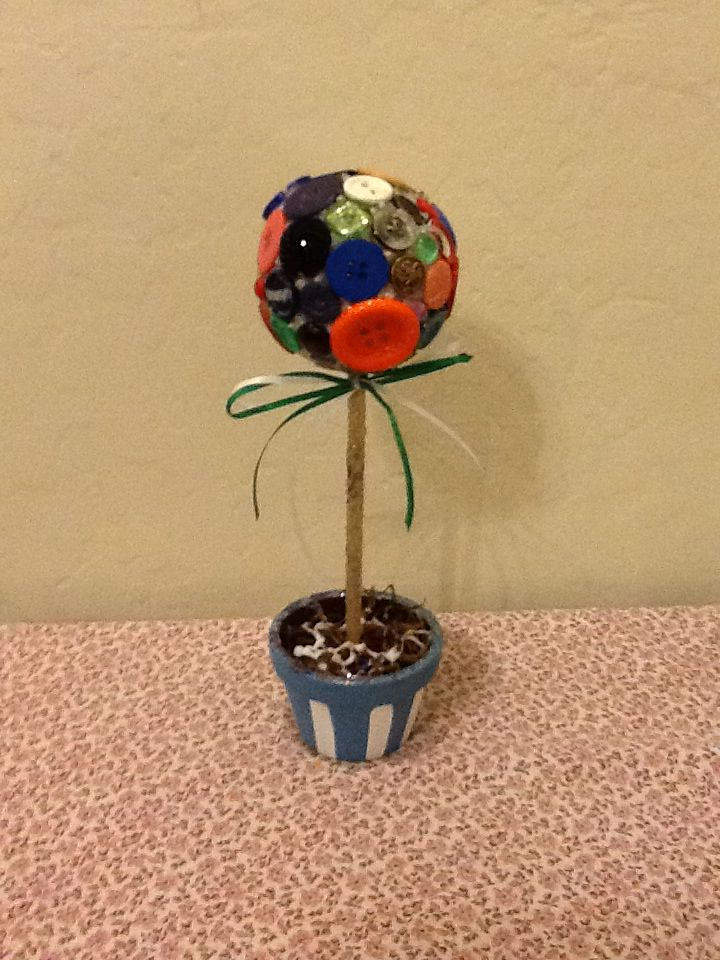 Button flower in sparkly pot.