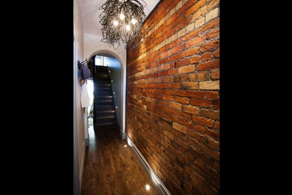 love this exposed brick and the light fitting - sophie and dale's hallway #theblock
