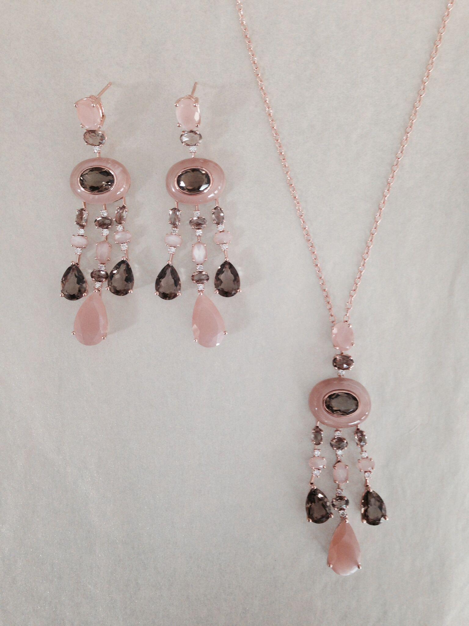 Smoky topaz rose quartz and diamonds are set in k rose gold to