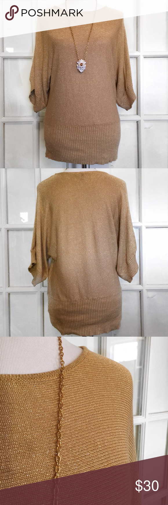 Cable & Gauge Gold Thread Dolman Sweater I love sparkly sweaters and this one is fantastic for the upcoming cold weather. Dolman, 3/4 length, wide sleeves and ribbed waist band. Wear with tights for an effortless style! Machine wash/Dry Flat Cable & Gauge Sweaters Crew & Scoop Necks