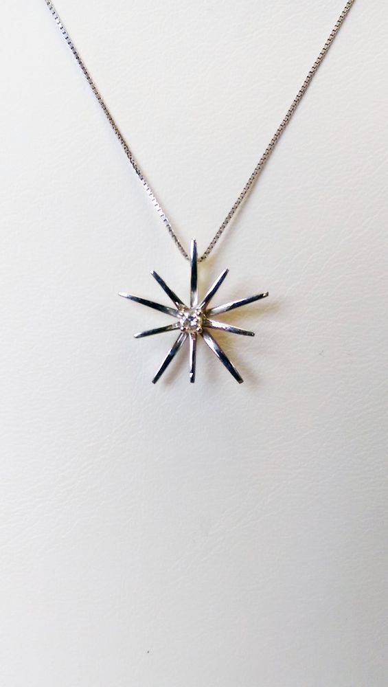 This necklace is simply lovely with a center diamond secured by four prongs with a #starfish like design surrounding the single #diamond in 18k white gold. The diamond is H in color and SI2 in clarity. The chain is 16 inches and is light in weight with a total of 2.45 grams. Enjoy the #pendant with chain for any occasion. $250