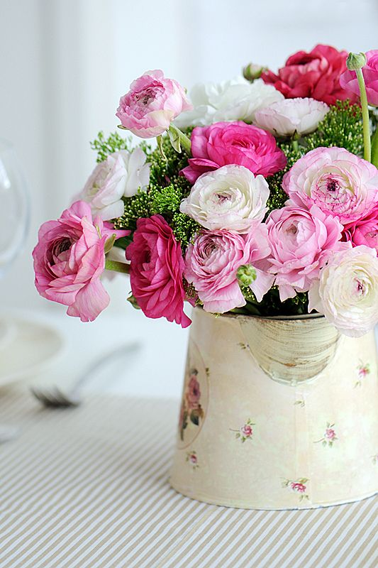 So shabby flowers in a watering can