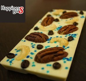 White Chocolate happiness bar with pecan nuts, blue sprinkle stars, roasted coffee beans and organic cashews.