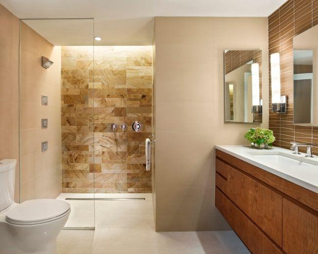 Badezimmer Fliesen Creme Braun Dusche Glaswand Holz Unterschrank