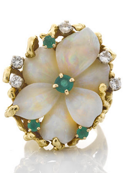 A carved opal, emerald and diamond flower ring carved opal flower measuring approximately: 26.1 x 19.5 x 7.7mm; signed Pac G.; mounted in eighteen karat gold.