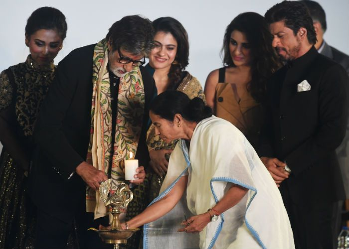 Bollywood stars Amitabh Bachchan, Shah Rukh Khan, Kajol and Parineeti Chopra along with West Bengal Chief Minister Mamata Banerjee light up the traditional lamp to inaugurate the 22nd Kolkata International Film Festival on November 11.