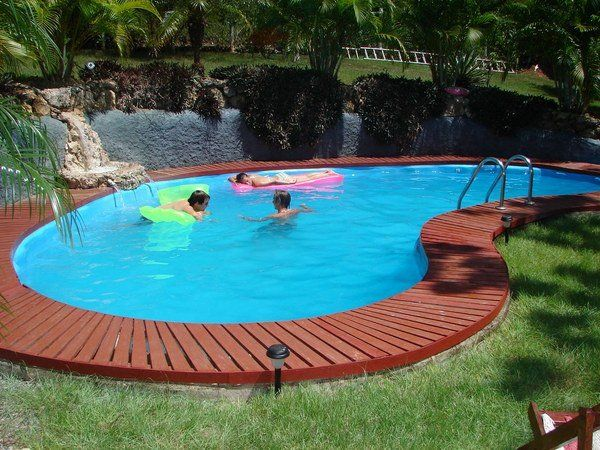 Small Kidney Shaped In Ground Swimming Pool Wooden Deck Ideas Patio Landscape Swimming Pools Backyard Backyard Pool Swimming Pool Designs