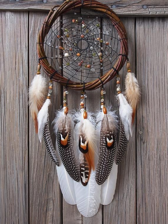 Dreamcatcher  Country Style  American Indian  Native american  Amulet  Shaman  Dreamcatcher Authentic  Wall hanging  Wall Decor is part of Dream catcher - Hoop diameter 2022 cm Length without loop 55 cm The dreamcatcher is made of feathers of natural color  A large wicker wicker hoop with a lot of beads creates a fabulous atmosphere, beads of two types of agate and dalmatian jasper are used  Agate enhances creativity and strengthens the intellect, contributes to the balance of yin and yang energy  Jasper cools hot temper, anger, strengthens emotional balance, also helps to improve logic and intuition  The dream catcher is unique and created with love, friendly feelings and great care  Production takes from 3 to 5 days  As so on as he is ready, the dream catcher is sent to the client
