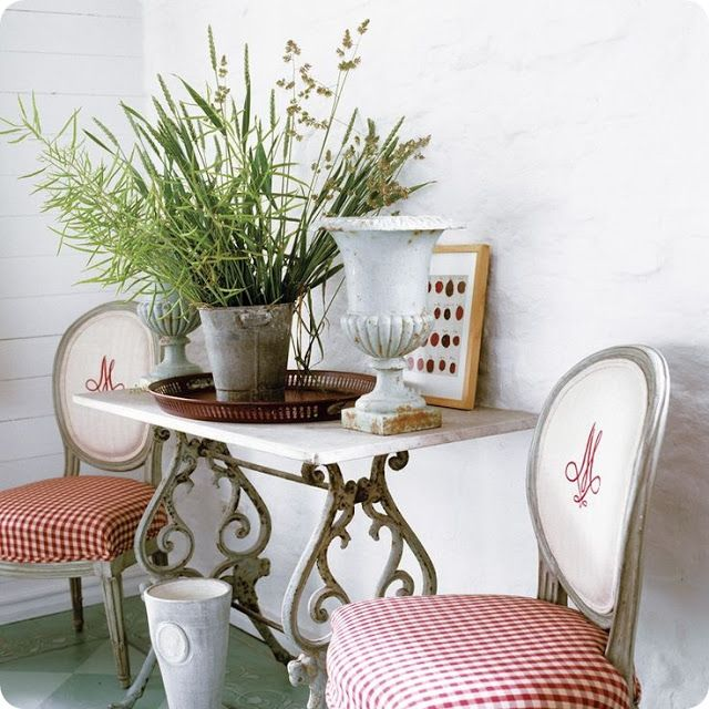 French chairs and red Swedish style checked fabric combined with the monogram on linen. Lovely idea!