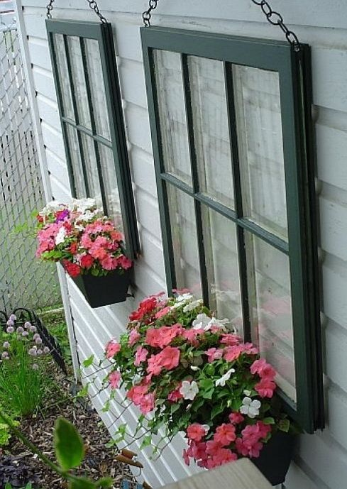 Elegant Recycled Pane Glass Windows Hung Onto The Side Of A House With A Flower Pot  Attached.