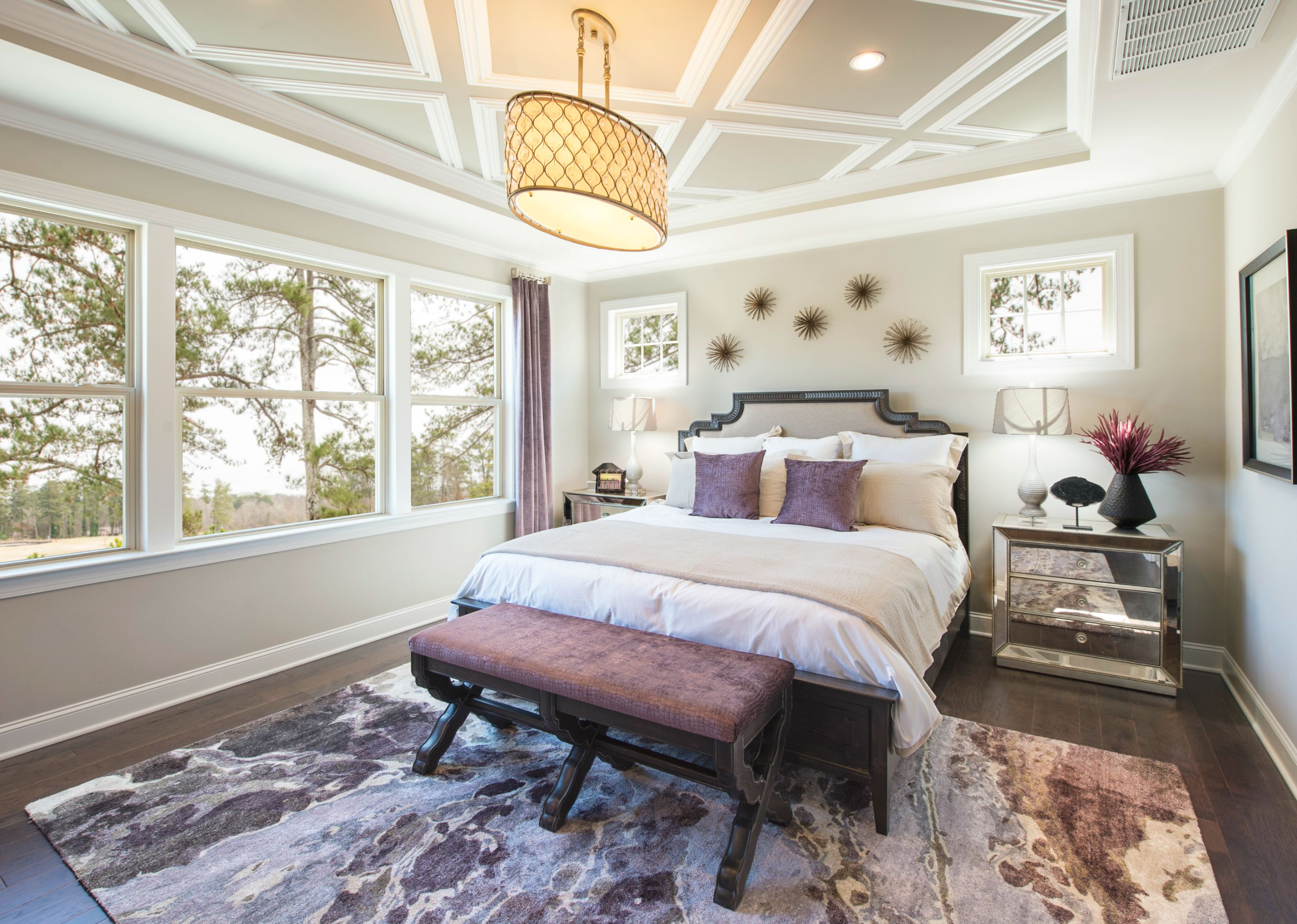 This contemporary bedroom has a subtle beige and purple color scheme