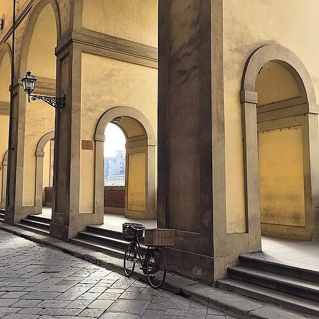 Basking in a moment alone alongside the arches of the Vasari Corridor.