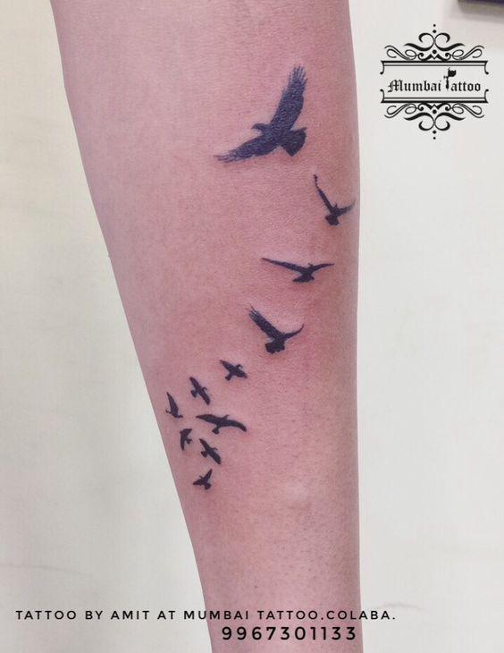 caebafa8d Beautiful free birds flying bird tattoo done near full wrist at Big Guys  Tattoo Studio perfect