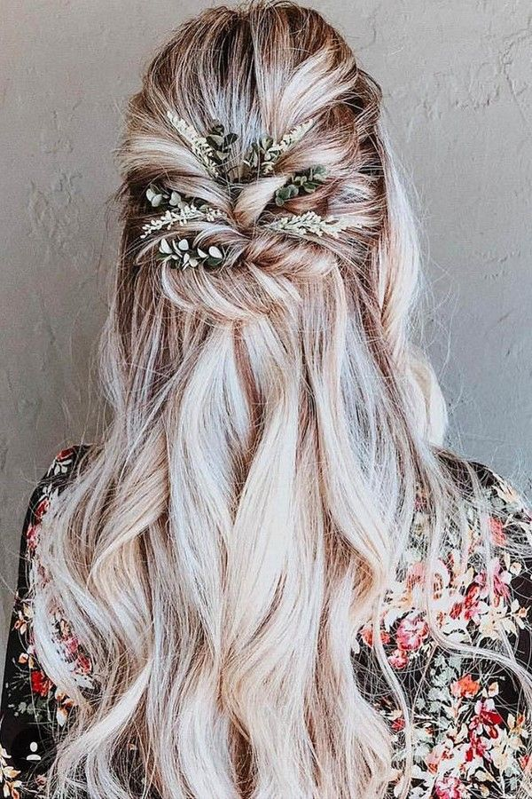 summer wedding hairstyles swept half up half down on long blonde hair with greenery…