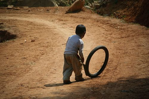 Image result for children riding tyre