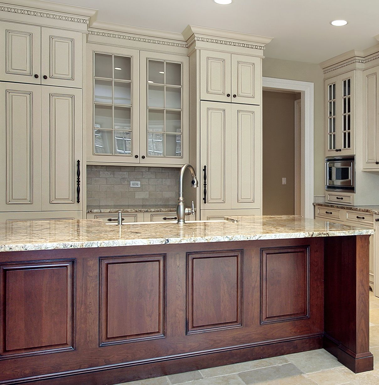 Prasada Kitchens And Fine Cabinetry: Antique White Kitchen With Large Stained Island. Kitchen