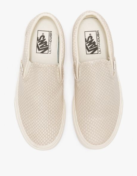 e300809ab8b9b7 Classic slip-ons in in Antique White with snake texture pattern from Vans.  Features low top construction