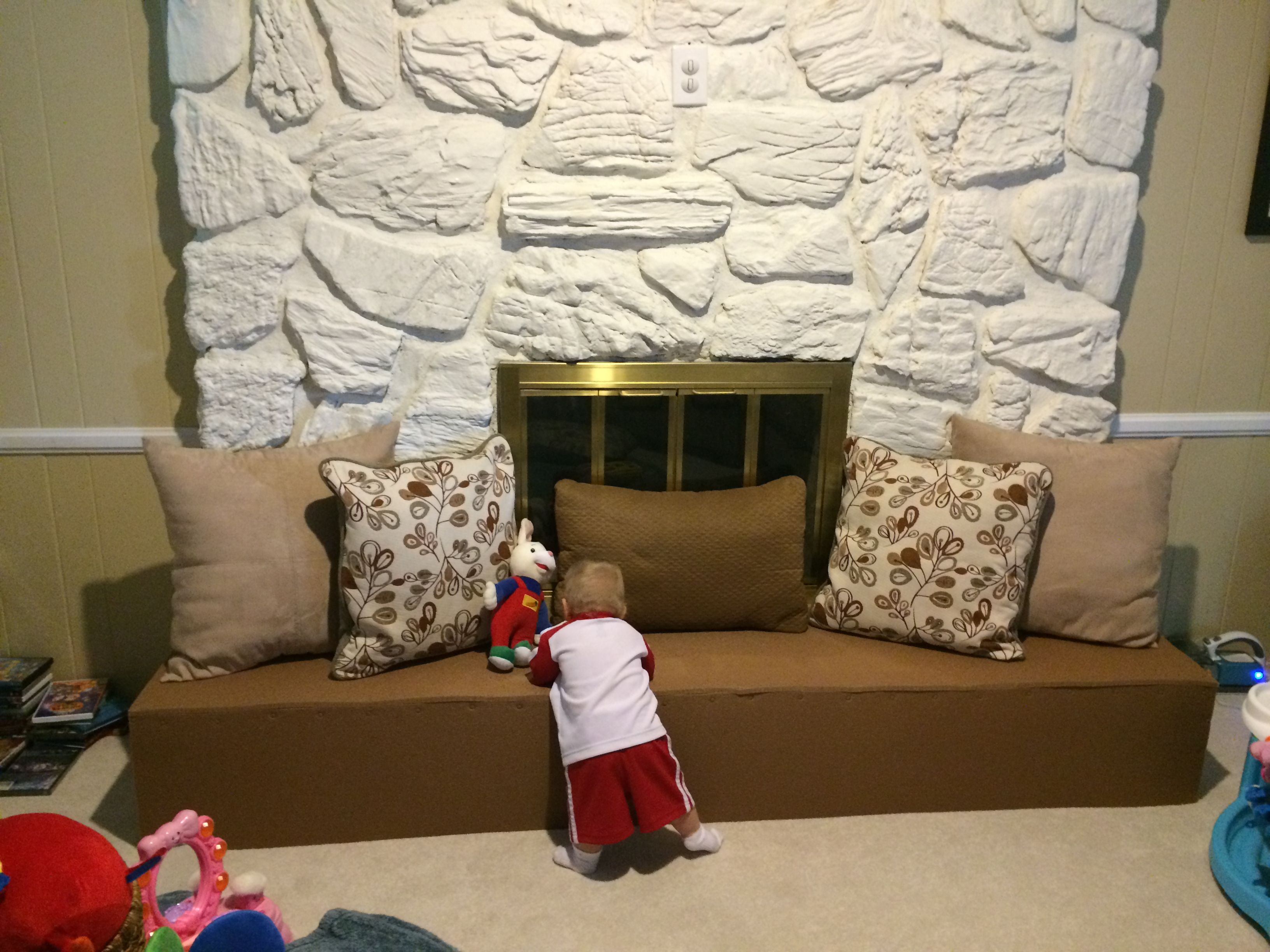 Baby Proof your Fireplace with our Fireplace Hearth Guard Pad-a recent after picture of a fireplace with our Hearth Guard providing the needed protection for your child