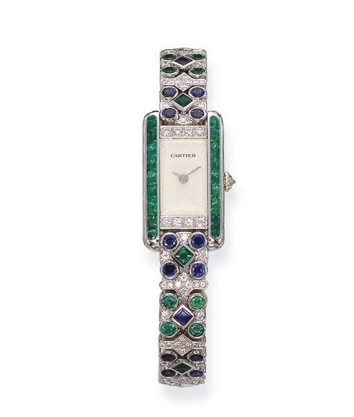 an emerald sapphire and diamond wristwatch by cartier the engine