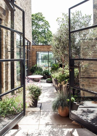 Beautiful back garden behind large glass doors concrete for Beautiful back doors