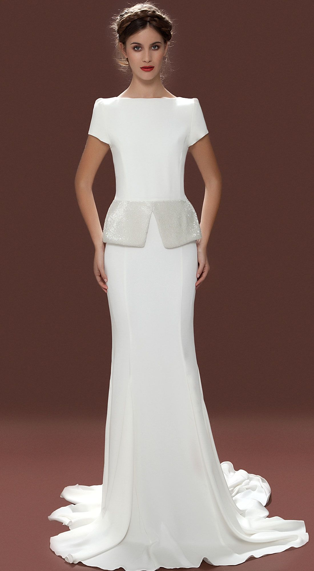 Fabulous Lara Hannah Elizabeth Dress The fashion forward yet modest Elizabeth wedding dress features an embellished peplum