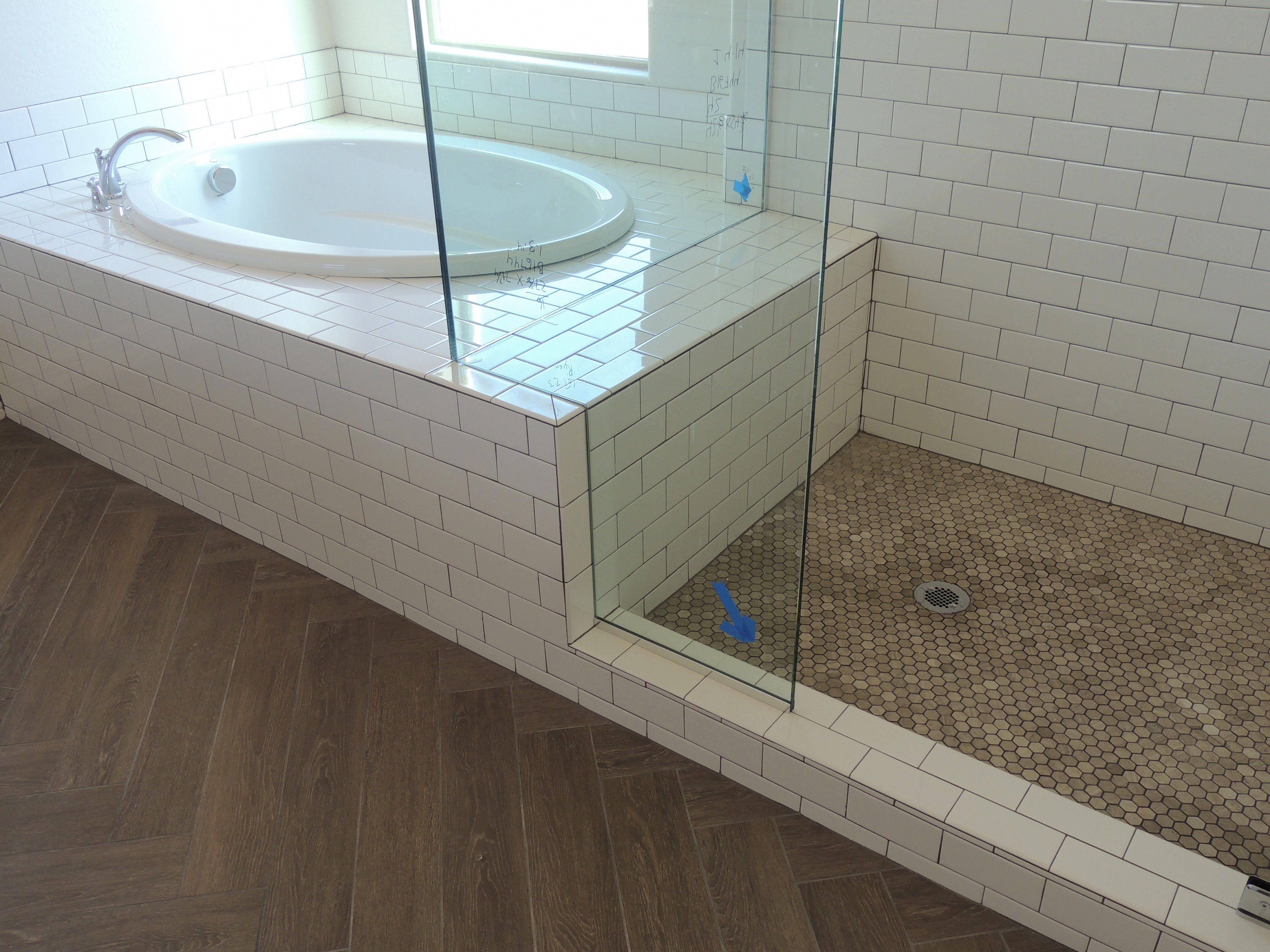 Chevron Herringbone Faux Wood Floor Tile Brown Gray White Subway Tile Tub And Shower Surround With Gray Grout Ba Faux Wood Tiles Wood Tile Bathroom Wood Tile