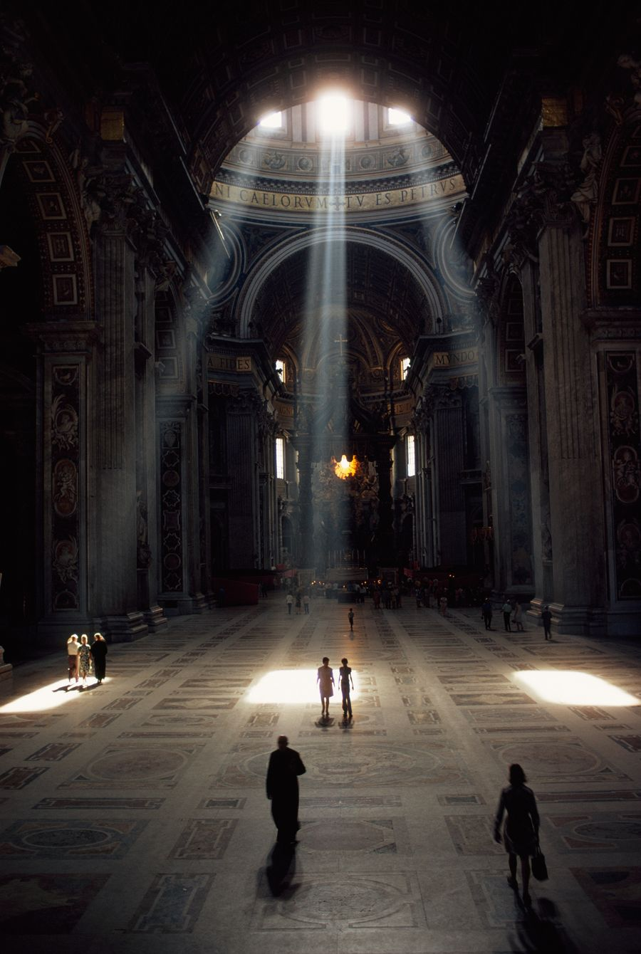 Three shafts of sunlight illuminate the basilica and its mosaic floor in the Vatican, December 1971.
