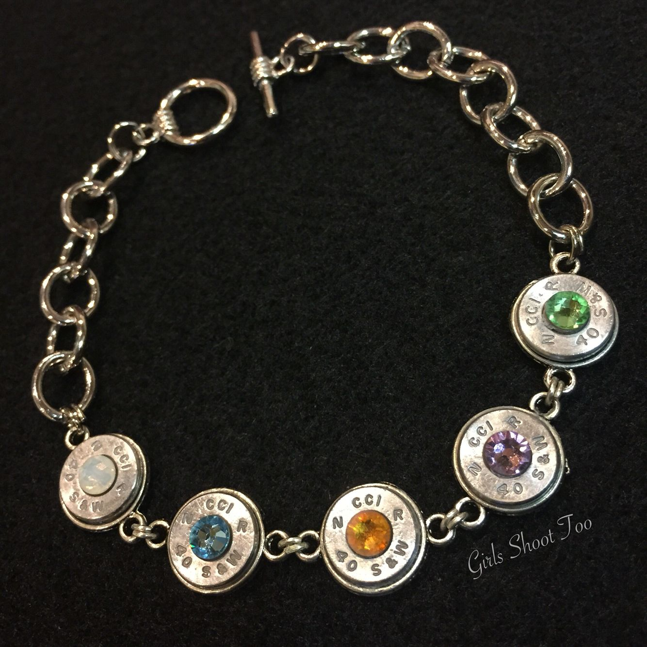 Custom parents+children birthstone bullet bracelet.   https://www.facebook.com/GirlsShootToo/