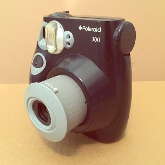 Polaroid camera -Polaroid 300 -change setting to light