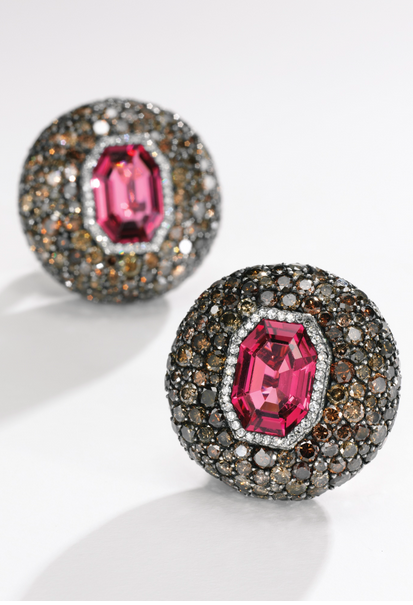 Pair of attractive spinel and diamond earclips, JAR Each set with an octagonal spinel, within a surround pavé-set with single- and brilliant-cut diamonds of brown tint and near colourless, signed JAR, French assay and maker's marks.