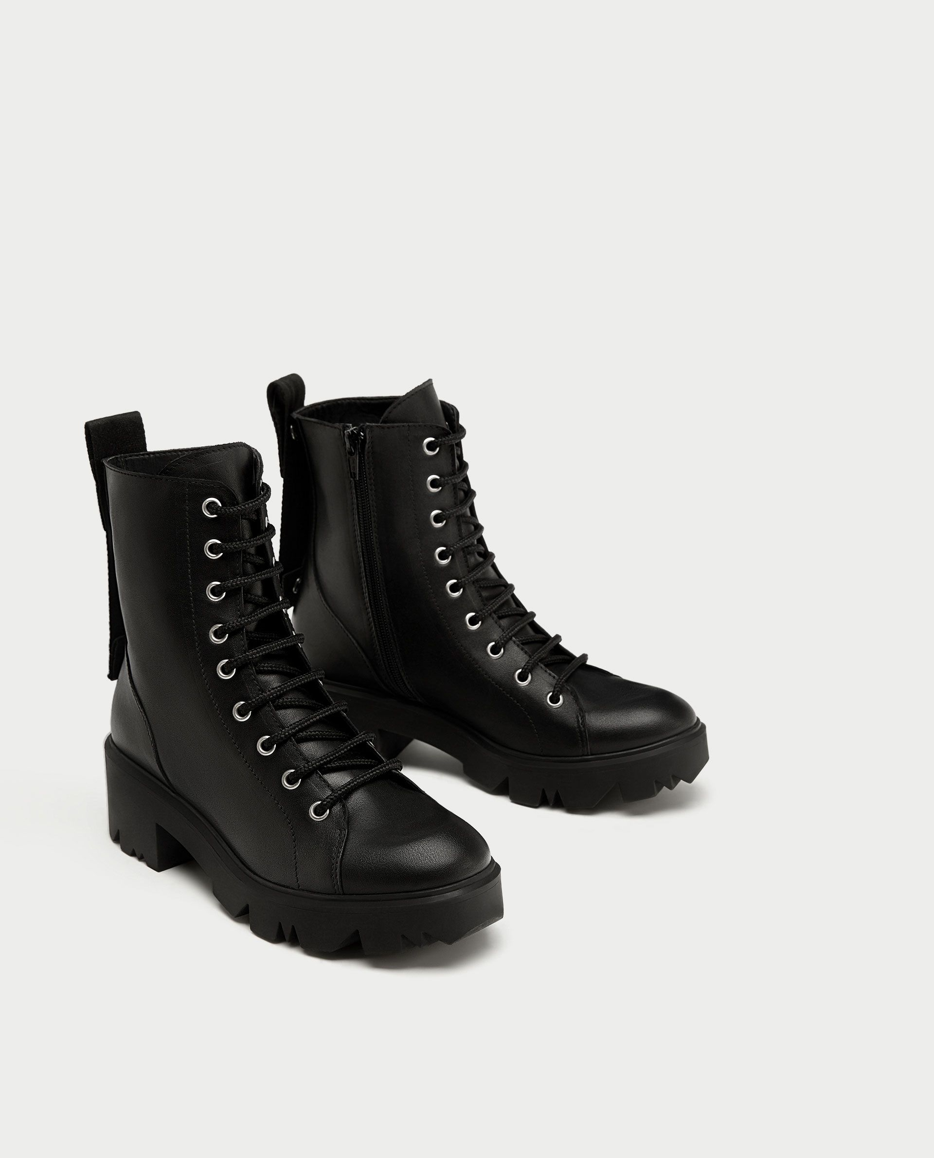 74bf2f866d8 Image 1 of FLAT LEATHER ANKLE BOOTS WITH SLOGAN from Zara ...