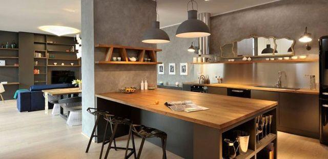Une cuisine ouverte contemporaine et chaleureuse. Crédit photo ...