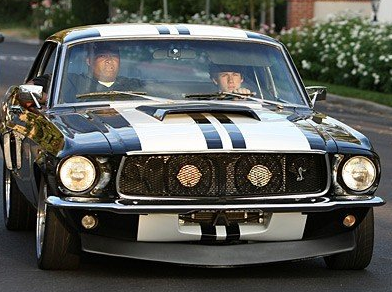 Nick Jonas driving his 1968 Ford Mustang